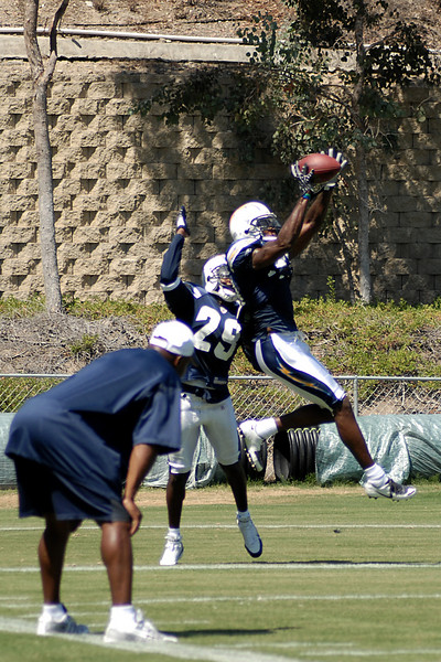 Two defensive backs going up for the ball during a drill for DB's