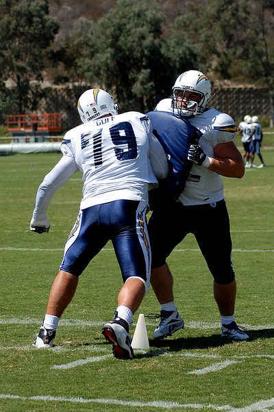 Mike Goff takes his turn at the one on one blocking drill.