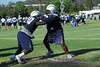 Barry Cryer #90 and Brandon McKinney #91 take each other on in a defensive line drill.