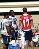 Lorenzo Neal, Antonio Gates, and Philip Rivers in a brief discussion during a break in practice.