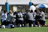 The defensive line takes time for an after practice prayer.