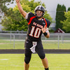 Record-Eagle/Brett A. Sommers Elk Rapids quarterback Alec Trautman throws a pass during Friday's game in Elk Rapids. The Rayders won 45-13.