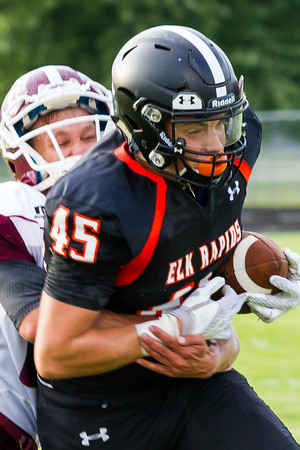 Record-Eagle/Brett A. Sommers Elk Rapids tight end Devin Sempert fights off a Charlevoix tackler after making a catch during Friday's game in Elk Rapids. The Rayders won 45-13.