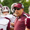 Record-Eagle/Brett A. Sommers Charlevoix head coach Ron Bindi addresses his team during Friday's game in Elk Rapids. The Rayders won 45-13.