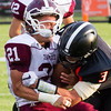 Record-Eagle/Brett A. Sommers Charlevoix running back Jared McLean takes a big hit from Elk Rapids defensive back John Boyles during Friday's game in Elk Rapids. The Rayders won 45-13.