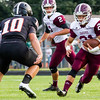 Record-Eagle/Brett A. Sommers Charlevoix running back Jared McLean sizes up Elk Rapids linebacker Alec Trautman during Friday's game in Elk Rapids. The Rayders won 45-13.