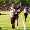Record-Eagle/Brett A. Sommers Elk Rapids wide receiver John Boyles makes sideline catch over Charlevoix defensive back Colin Smith during Friday's game in Elk Rapids. The Rayders won 45-13.