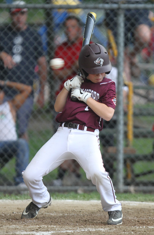 . Chelmsford wins over Burlington in EMass 11-year-old Cal Ripken State Tournament and will go on to New England Regional in Maine. Chelmsford\'s Ryan Higgins (7) ducks away from an inside pitch before singling in the bottom of the second inning. (SUN/Julia Malakie)