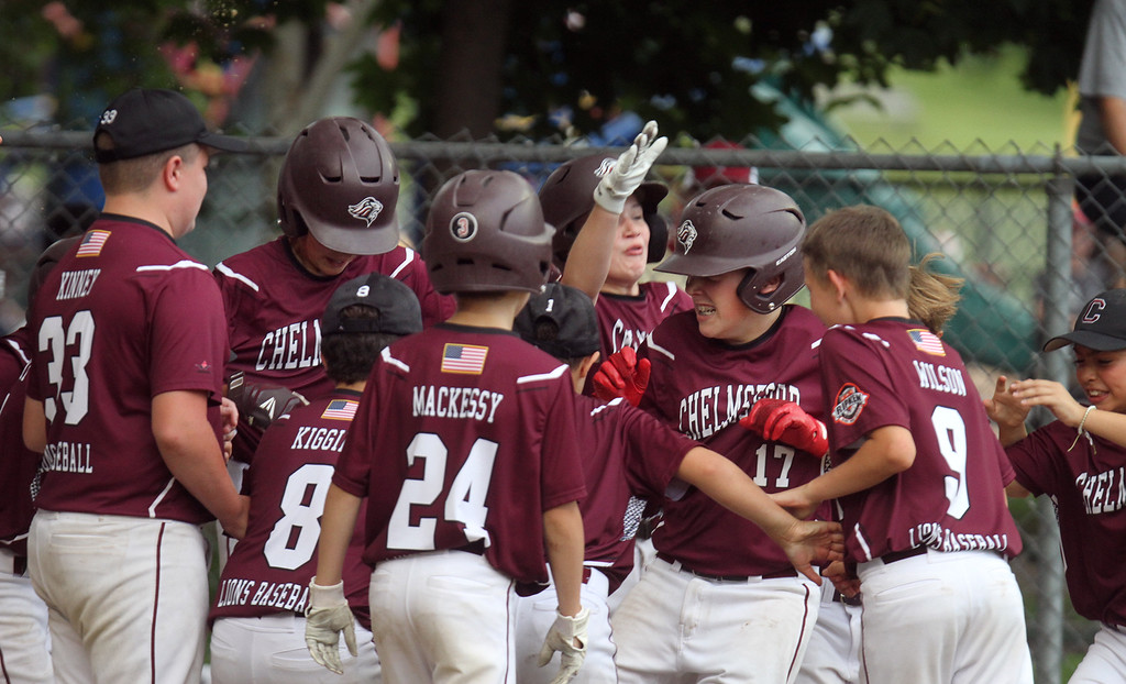 . Chelmsford wins over Burlington in EMass 11-year-old Cal Ripken State Tournament and will go on to New England Regional in Maine. Chelmsford\'s Keegan Briere (17) is mobbed by teammates after hitting a solo home run in the bottom of the fourth inning to give Chelmsford a 10-0 lead and the win based on the mercy rule. (SUN/Julia Malakie)