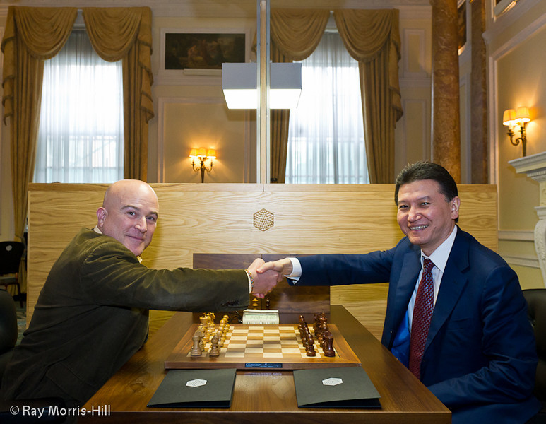 Andrew Paulson shakes hands with KIrsan Ilyumzhinov prior to Round 1, 21 September 2012
