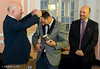 Andrew Paulson presents the winner's medal to Veselin Topalov.   Geoffrey Borg, FIDE CEO, is on the right.