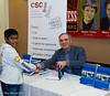 Garry Kasparov signs his book for a young fan