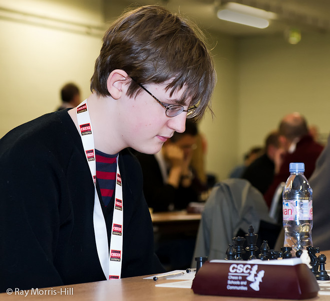 Jude Lenier playing in Round 8 of the FIDE Open