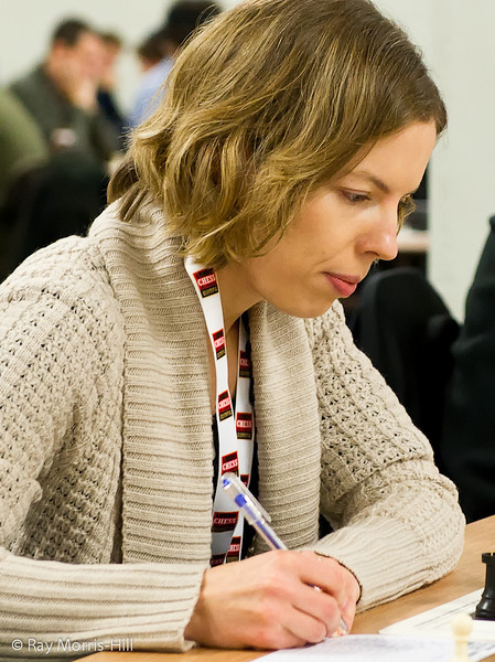 Maria Yurenok playing in Round 8 of the FIDE Open