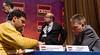 Viswanathan Anand vs Michael Adams.  Deputy Arbiter David Sedgwick in the background