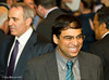 Vishy Anand at the evening reception at Simpson's-in-the-Strand.  Garry Kasparov in the background.