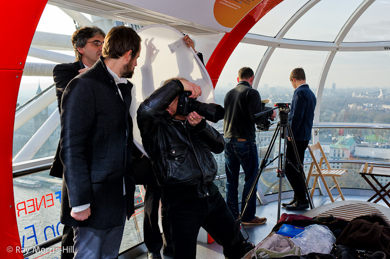 Shadow puppetry makes a comeback in the London Eye.   Magnus Carlsen surveys the city in the background.