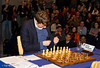 Luke McShane looks for his lucky pen at the start of his Round 1 match with Magnus Carlsen