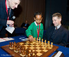 Michael Adams gets some help on his first move in his game against Magnus Carlsen