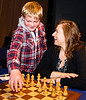 Judit Polgar shares a joke with her young assistant at the start of Round 7