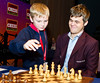 Round 4 starts with 1.d4 for Magnus Carlsen, but he retracted and played 1. e4
