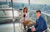Judit Polgar and Magnus Carlsen high above London