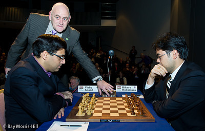 Round 8: Albert Vasse starts the clock for Vishy Anand and Gawain Jones