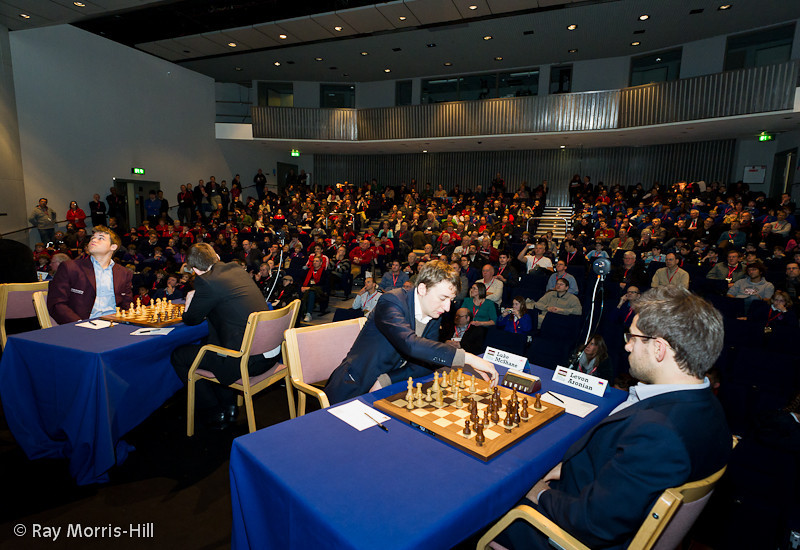 A packed auditorium at the start of Round 4