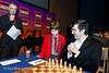 Joshua Altman prepares to make the first move for Vladimir Kramnik in his Round 3 clash with Magnus Carlsen