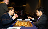 Chief Arbiter Albert Vasse starts for the clock for the Round 1 clash between Levon Aronian and Hikaru Nakamura