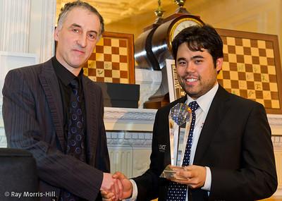 Malcolm Pein presents the London Chess Classic trophy to Hikaru Nakamura