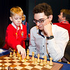 Fabiano Caruana gets some help at the start of Round 3