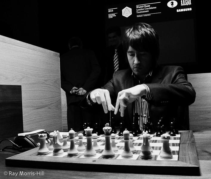 Arbiter Adam Raoof watches Teimour Radjabov  adjust his pieces at the start of Round 5