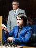 Teimour Radjabov shoots his cuffs at the start of his Round 3 game against Peter Svidler.  Arbiter Carlos Oliveira Dias in the background