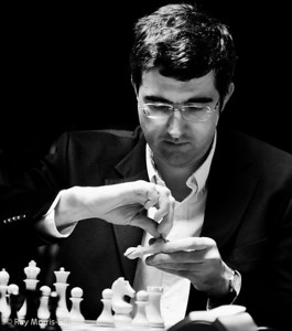 Vladimir Kramnik repairing his bishop at the start of Round 13