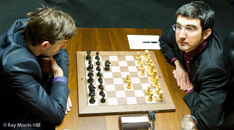 Round 3:  Alexander Grischuk (left) defends Black against Vladimir Kramnik