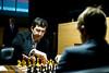 Chief Arbiter Werner Stubenvoll looks on as Vladmir Kramnik and Magnus Carlsen start their Round 9 game
