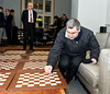 Vassily Ivanchuk signs the chess boards, Chief Arbiter Werner Stubenvoll in the background, standing
