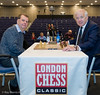 Chris Fegan, CSC takes on Ken Clark of Newham Council on stage at the London Chess Classic