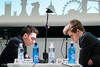 Round 2: Magnus Carlsen (right) vs Fabiano Caruana