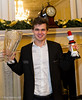 Magnus Carlsen is presented with the trophies for the Grand Chess Tour and London Chess Classic