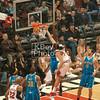 Joakim Noah with an early dunk over Okafor