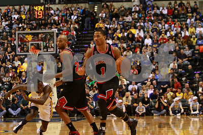 1/14/11- Derrick Rose(#1) brings the ball up the court as Darren Collison (#2) fights to get around a pick set by Tai Gibson (#22) as the Bulls prevailed 99 to 86 against the Indiana Pacers.  Photo/Ron Foster Sharif