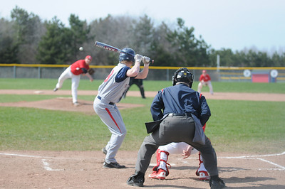 Tyler Williams delivers a pitch against Big Rapids in CSAA action Tuesday, May 6, 2014.  Joe Buczek - The Morning Sun