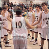 Matt Hamilton/The Daily Citizen<br /> Christian Heritage basketball player Ivy Acres is greeted by teammates as he takes to the court while being introduced before the Lions' game against the Harvester Hawks Friday night at Christian Heritage School.