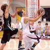 Matt Hamilton/The Daily Citizen<br /> CHS14 drives toward the basket past FR12 Saturday.
