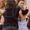 Matt Hamilton/The Daily Citizen<br /> Senior CHS25 Ann Marie Massengale hugs coach Heather Lowery as she leaves the court Friday.