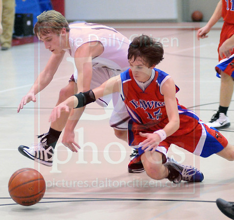 Matt Hamilton/The Daily Citizen<br /> CHS Hutch Crawford and H Alex Carter battle for a loose ball Friday.