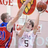 Matt Hamilton/The Daily Citizen<br /> CHS Cole Maffetone puts up a shot around the long arm of H Garrett Jones.
