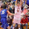 Matt Hamilton/The Daily Citizen<br /> C44 Cameron Locke puts up a 3 as T35 Landon Barrett defends Friday.